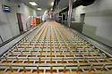 """19/06/16<br /> <br /> Nick Tanzarella, production manager, watches as sticks are added to production line.<br /> <br /> """"The last couple of days have sent the factory into meltdown,"""" exclaimed Pasquale Tanzarella, director of one of the UK's largest independent ice-lolly manufacturers.<br /> <br /> In fact, today alone, his factory will make more than 200,000 ice lollies, which will be sold up and down the country through traditional ice-cream vans and shops. <br /> <br /> Demand has been so high because of the recent hot spell that the cold rooms at Franco's ices, in Kempston, Bedfordshire, are already full to bursting, with more than 40 different varieties of ice-cream and ice-lollies, and today's production of Tasty Orange lollies will probably be on sale by late afternoon.<br /> <br /> The lollies start life in a huge 2,000-litre vat, as a syrupy, bright orange liquid, before being poured into the traditional ice-lolly moulds.<br /> <br /> From there they are passed over a fast-freezer, at around -36C, to super cool the liquid into ice, which only takes around 20 minutes, before being loaded into their colourful outer wrapper.<br /> <br /> And then it's straight into wholesale boxes, stored in the factory's cold rooms, and sold the very same day.<br /> <br /> It's a super success story for this family-run business, which was founded in1964 by Pasquale's father, Domenico Tanzarella, originally to sell ice-creams through a local chain of vans.<br /> <br /> """"In the 70s we used to only supply vans within about a 60-mile radius of the factory,"""" said Pasquale.<br /> <br /> """"But we've grown steadily over the years and now we export to Cyprus, Ireland and even South Africa, as well as being one of the biggest suppliers here in the UK.<br /> <br /> """"Our best seller by far is the Mr Bubble ice-lolly,"""" said Pasquale. """"We were the very first company to launch a bubble gum flavoured lolly and it's been our best seller ever since.""""<br /> <br /> Last year they sold more than f"""