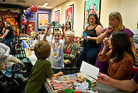 Boy opens presents at a birthday party.