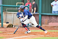 Elizabethton Twins Willie Joe Garry Jr. (23) swings at a pitch during a game against the Kingsport Mets at Joe O'Brien Field on July 6, 2019 in Elizabethton, Tennessee. The Twins defeated the Mets 5-3. (Tony Farlow/Four Seam Images)