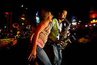 Customers sing with the musicians at the Howl at the Moon nightclub in Charlotte, NC. Photos taken with permission of bar management.