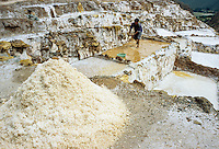 Peru.  Maras Salt Pans, Urubamba Valley.  Man Collecting Salt.