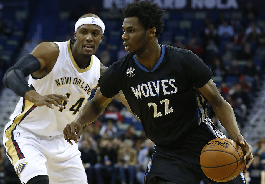Minnesota Timberwolves guard Andrew Wiggins (22) drives against New Orleans Pelicans forward Dante Cunningham (44) during the first half of an NBA basketball game Tuesday, Jan. 19, 2016, in New Orleans. The Pelicans won 114-99. (AP Photo/Jonathan Bachman)