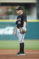 Kannapolis Intimidators first baseman Andrew Vaughn (14) blows a bubble with his gum while on defense against the Augusta GreenJackets at SRG Park on July 6, 2019 in North Augusta, South Carolina. The Intimidators defeated the GreenJackets 9-5. (Brian Westerholt/Four Seam Images)