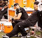 December 2009: New Orleans Saints quarterback Drew Brees (9) watches the game from the sidelines during an NFL football game at the Louisiana Superdome in New Orleans.  The Cowboys defeated the Saints 24-17.