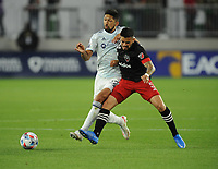 WASHINGTON, DC - MAY 13: Mauricio Pineda #22 of Chicago Fire FC battles for the ball with Junior Moreno #5 of D.C. United during a game between Chicago Fire FC and D.C. United at Audi FIeld on May 13, 2021 in Washington, DC.
