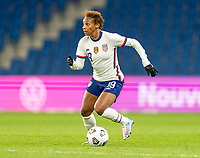 LE HAVRE, FRANCE - APRIL 13: Crystal Dunn #19 of the USWNT dribbles during a game between France and USWNT at Stade Oceane on April 13, 2021 in Le Havre, France.