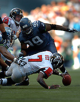 Sep 18, 2005; Seattle, WA, USA; Atlanta Falcons quarterback Michael Vick #7 is sacked by the Seattle Seahawks in the fourth quarter at Qwest Field. Mandatory Credit: Photo By Mark J. Rebilas