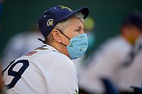Savannah Bananas grandma coach Marty Barrington watches the action while wearing a protective mask during a Collegiate Summer League game against the Macon Bacon on July 15, 2020 at Grayson Stadium in Savannah, Georgia.  (Mike Janes/Four Seam Images)