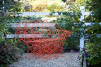 Orange chair, bench garden whimsy