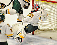 11 February 2011: University of Vermont Catamount goaltender Roxanne Douville, a Freshman from Beloeil, Quebec, falls backward as she gives up a goal to the University of New Hampshire Wildcats at Gutterson Fieldhouse in Burlington, Vermont. The Lady Catamounts defeated the visiting Lady Wildcats 4-2 in Hockey East play. Mandatory Credit: Ed Wolfstein Photo