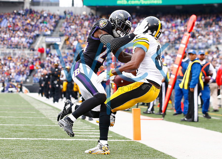Antonio Brown #84 of the Pittsburgh Steelers catches a touchdown pass in front of Kyle Arrington #24 of the Baltimore Ravens that was later reversed on a challenge flag in the first half during the game at M&T Bank Stadium on December 27, 2015 in Baltimore, Maryland. (Photo by Jared Wickerham/DKPittsburghSports)