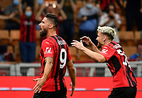 Calcio, Serie A: AC Milan - Cagliari calcio, Giuseppe Meazza (San Siro) stadium, Milan on August 29, 2021.  <br /> Milan's Olivier Giroud (l) celebrates after scoring with his teammate Alexis Saelemaekers (r) during the Italian Serie A football match between Milan and Cagliari at Giuseppe Meazza stadium, on August 29, 2021.  <br /> UPDATE IMAGES PRESS/Isabella Bonotto