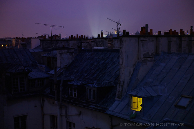 Rooftops are seen at twilight in the 6th arrondisement of Paris on 3 January 2010.