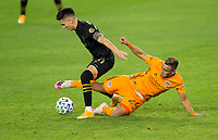 CARSON, CA - OCTOBER 28: Darwin Ceren #24 of the Houston Dynamo slide tackles Eduard Atuesta #20 of the Los Angeles FC during a game between Houston Dynamo and Los Angeles FC at Banc of California Stadium on October 28, 2020 in Carson, California.