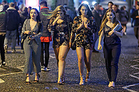 Pictured: Four women walk in Wind Street, Swansea, south Wales, UK. Friday 21 December 2018<br /> Re: Black Eye Friday, also known as Mad Friday or Black Friday which is the last Friday before Christmas Day.