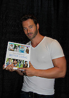 "Days of Our Lives Eric Martsolf ""Brady Black"" holds the ""Days of Our Lives Better Living"" as he appears at the 12th Annual Comcast Women's Expo on September 7 (also 6th), 2014 at the Connecticut Convention Center, Hartford, CT. He signed photos, posed with fans, walked the runway with models from Kathy Faber Designs Fashion Show, and broke some boards at Villari's Martial Arts Centers booth with Maggie and Ryan Farley.  (Photo by Sue Coflin/Max Photos)"