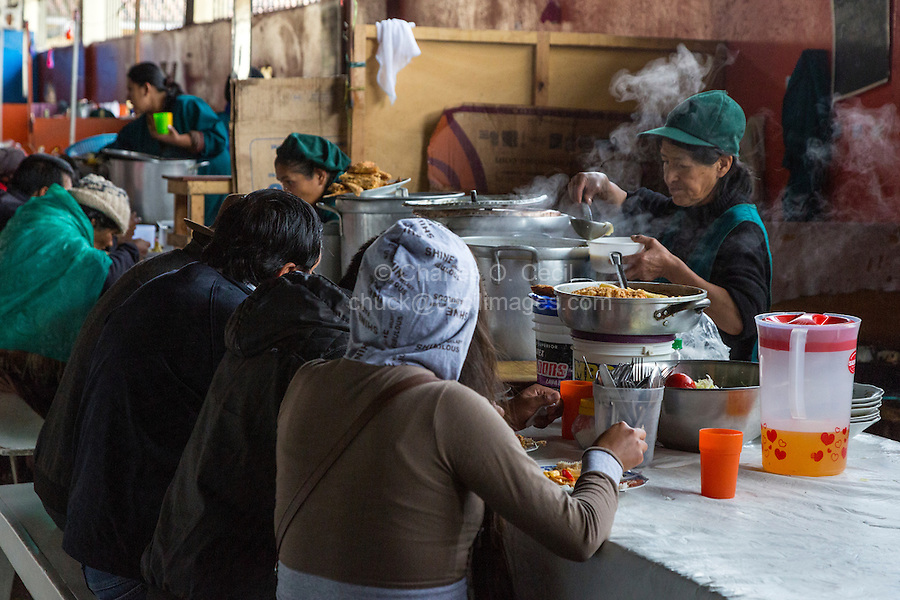 Peru, Cusco, San Pedro Market.  Woman Dishing up a Serving in the Food Court Area of the Market.