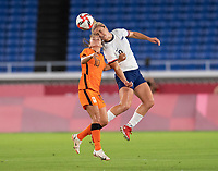 YOKOHAMA, JAPAN - JULY 30: Danielle van de Donk #10 of the Netherlands goes up for a header with Lindsey Horan #9 of the USWNT during a game between Netherlands and USWNT at International Stadium Yokohama on July 30, 2021 in Yokohama, Japan.