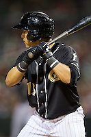 Carlos Sanchez (13) of the Charlotte Knights at bat against the Buffalo Bisons at BB&T Ballpark on May 9, 2014 in Charlotte, North Carolina.  The Knights defeated the Bisons 5-3.  (Brian Westerholt/Four Seam Images)