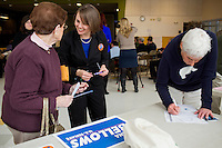 """Shenna Bellows, Democratic candidate in Maine for US Senate, speaks with Shirley Rosen after Bellows spoke to the Portland Democratic City Committee town caucus in the East End School cafeteria in Portland, Maine, USA, on March 3, 2014. Bellows is trying to unseat incumbent Maine Republican Senator Susan Collins in the 2014 election. Rosen, a retired state employee, said, """"After listening to her today, I told her she has my vote. Weneed to get rid of this governor and get more democrats in the Senate."""" The town caucus had speeches from various other local candidates and also served to choose delegates for the 2014 Maine State Democratic Caucus."""