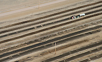 Harvesting manure at cattle feedlot.  Near Lamar, CO.  April 2013.  84761