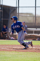 Texas Rangers catcher Matt Whatley (64) starts down the first base line during an Instructional League game against the San Diego Padres on September 20, 2017 at Peoria Sports Complex in Peoria, Arizona. (Zachary Lucy/Four Seam Images)