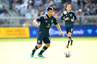 KANSAS CITY, KS - JUNE 26: Roger Espinoza #15 Sporting KC with the ball during a game between Los Angeles FC and Sporting Kansas City at Children's Mercy Park on June 26, 2021 in Kansas City, Kansas.