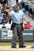 Home plate umpire Mike Muchlinski makes a call during a game between the Kansas City Royals and Chicago White Sox at U.S. Cellular Field on August 14, 2011 in Chicago, Illinois.  Chicago defeated Kansas City 6-2.  (Mike Janes/Four Seam Images)
