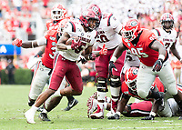 ATHENS, GA - OCTOBER 12: Rico Dowdle #5 of the South Carolina Gamecocks runs the ball in overtime during a game between University of South Carolina Gamecocks and University of Georgia Bulldogs at Sanford Stadium on October 12, 2019 in Athens, Georgia.