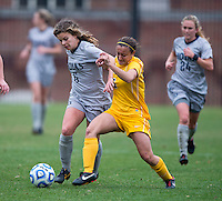 Daphne Corboz (6) of Georgetown fights for the ball with Kari Nickels (5) of La Salle during the first round of the NCAA tournament at Shaw Field in Washington, DC.  Georgetown defeated La Salle, 2-0.