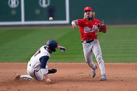 Second baseman Colton Bauer (8) of the Ohio State Buckeyes throws to first after putting out Justin Janas in a game against the Illinois Fighting Illini on Friday, March 5, 2021, at Fluor Field at the West End in Greenville, South Carolina. (Tom Priddy/Four Seam Images)