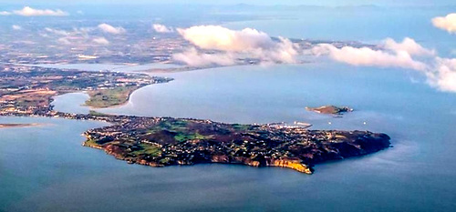 Howth Peninsula from the southeast. With Ireland's Eye on its doorstep and spectacular sea cliffs, clean beaches and sandy inlets nearby, Howth Harbour has become a magnet for new generations of personally-propelled watercraft