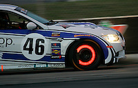 Brake rotors glow on a BMW sports car during a Grand-Am Continental Series race at Trois-Rivieres, Quebec, Canada, August 2010.  (Photo by Brian Cleary/www.bcpix.com)