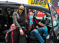 Jul 18, 2020; Clermont, Indiana, USA; NHRA funny car driver Alexis DeJoria (left) with father John Paul DeJoria during qualifying for the Summernationals at Lucas Oil Raceway. Mandatory Credit: Mark J. Rebilas-USA TODAY Sports