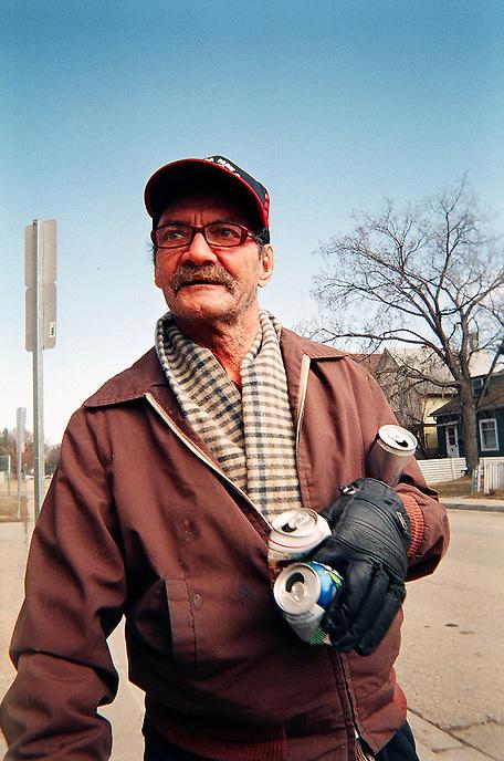 Englebert Diebel hunts for cans to make some pocket change. MARK TAYLOR GALLERY