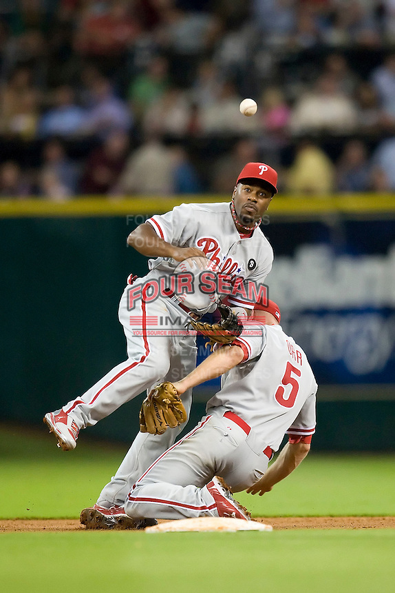 Philadelphia Phillies shortstop Jimmy Rollins #11 runs into second baseman Pete Orr #5 while fielding a grounder during the Major League Baseball game against the Houston Astros at Minute Maid Park in Houston, Texas on September 12, 2011. Houston defeated Philadelphia 5-1.  (Andrew Woolley/Four Seam Images)