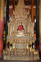 Myanmar, Burma.  Buddha Shrine in the Nga Hpe Kyaung (Jumping Cat) Monastery, Inle Lake, Shan State.