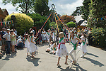 Children dancing around a May Pole Petersham village fete Richmond Surrey UK. Middle class white anglo saxon Britain. 2010s 2011 UK