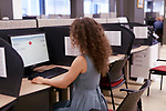 Woman using computer at Service Canada office in British Columbia, Canada Image © MaximImages, License at https://www.maximimages.com