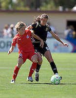 Joanna Loehman (left) and Brandi Chastain (6) battle for control of the ball. FC Gold Pride defeated Washington Freedom 3-2 at Buck Shaw Stadium in Santa Clara, California on August 1, 2009.