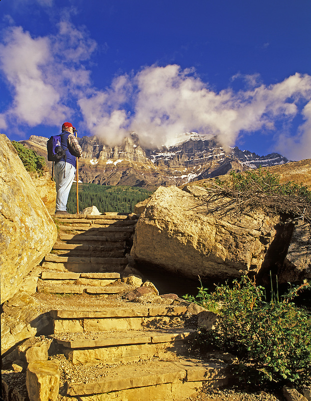 Hiker on steps at Moraine Lake. Banff National Park, Canada