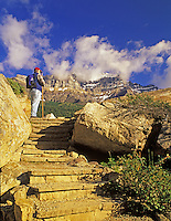 Hiker on steps at Moraine Lake. Banff National Park, Canada