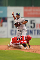 Jamestown Jammers second baseman Jhonathan Barrios #17 attempts to turn a double play as Chad Wallach #55 slides in during a game against the Batavia Muckdogs on June 27, 2013 at Dwyer Stadium in Batavia, New York.  The game was postponed in the 4th inning due to rain.  (Mike Janes/Four Seam Images)