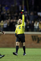 WINSTON-SALEM, NC - DECEMBER 07: Referee Robert Sibiga shows the yellow card during a game between UC Santa Barbara and Wake Forest at W. Dennie Spry Stadium on December 07, 2019 in Winston-Salem, North Carolina.