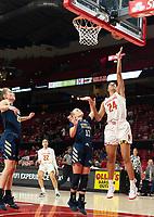 COLLEGE PARK, MD - NOVEMBER 20: Stephanie Jones #24 of Maryland shoots over Tori Hyduke #11 of George Washington during a game between George Washington University and University of Maryland at Xfinity Center on November 20, 2019 in College Park, Maryland.