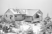Greenleaf Hut in extreme weather conditions during the winter months in the White Mountains, New Hampshire USA. On a clear day Mount Lafayette can be seen in the background.