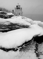 Snow covers the rocky cliffs at Castle Hill Lighthouse