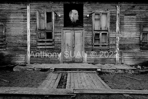 Osyatkino, Russia  .1998.In a village only accessible by the Pinega River an administration building still carries the fading Lenin poster above the doorway..