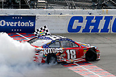 #18: Kyle Busch, Joe Gibbs Racing, Toyota Camry Skittles Red White & Blue celebrates his win with a burnout