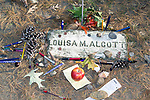 "Author Lousia May Alcott grave site.  Author of ""Little Women"", she is one of 3 daughters from the famed Alcott family in Concord, Massachusetts.  Louisa was a nurse during the Civil War, hence her plaque and American Flag on display at her grave site."